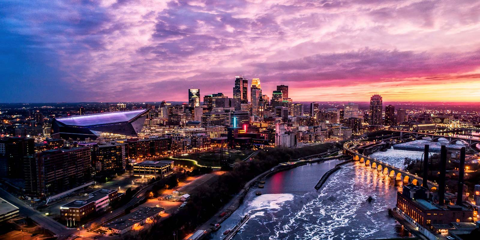 Minneapolis skyline with colorful sunset