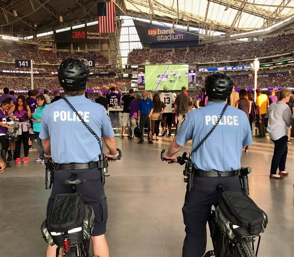 Two officers on bikes at an event.