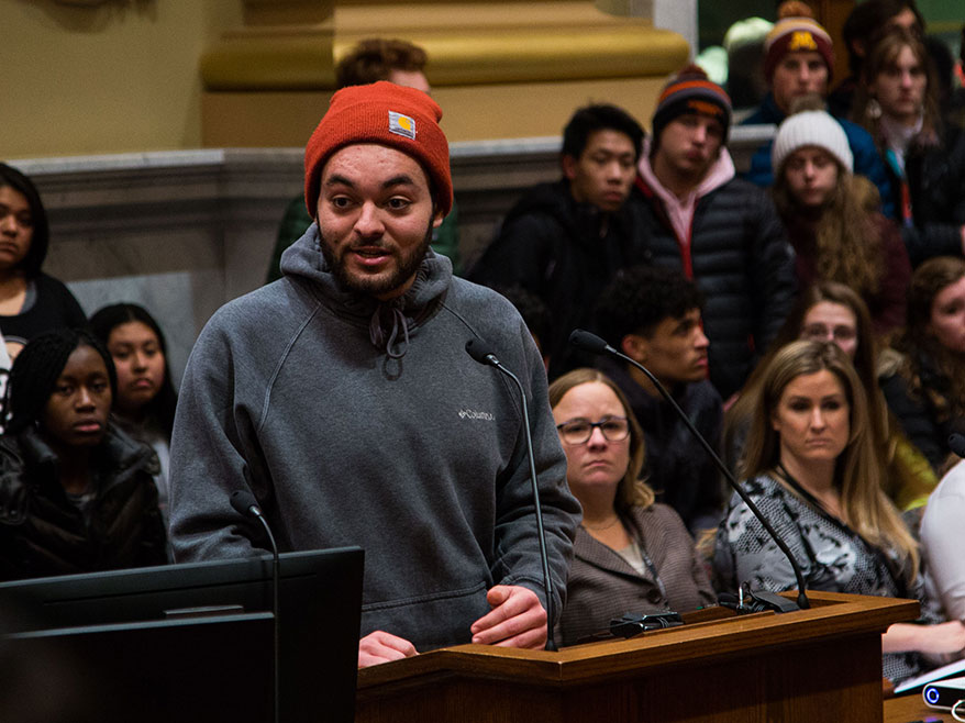 A young man addresses City Council at a public hearing