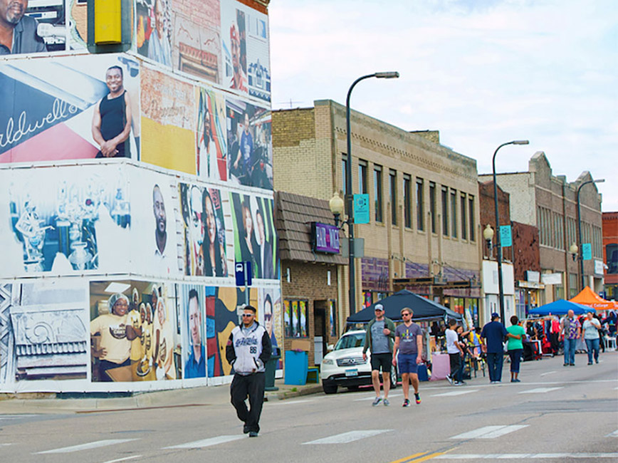 People walking through Open Streets Mpls 2019 in North Minneapolis.