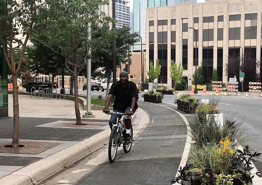 Person riding bike wearing hat