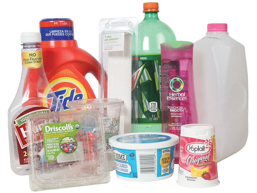 Various plastic containers, such as milk jug and yogurt and berry containers